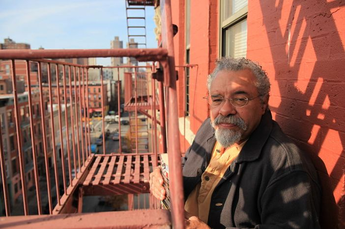 Jesus Papoleto Melendez on the fire escape of his building on East 111th Street in East Harlem New York City. Photo By vagabond (Own work) [CC BY-SA 3.0}