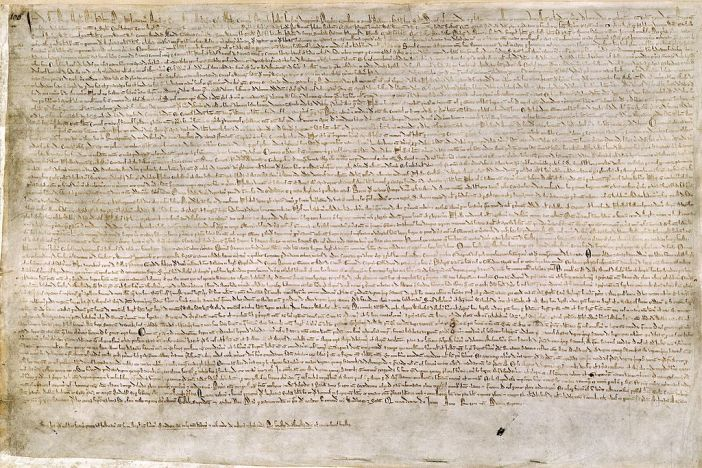 The Magna Carta (originally known as the Charter of Liberties) of 1215, written in iron gall ink on parchment in medieval Latin, using standard abbreviations of the period, authenticated with the Great Seal of King John. The original wax seal was lost over the centuries.[1] This document is held at the British Library and is identified as