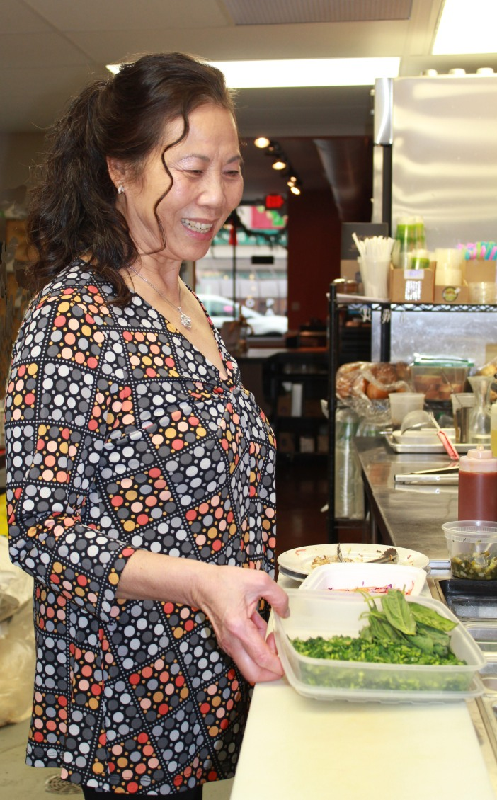 Coco Tran in her Roots & Soy Kitchen  photo from Flavors from Home